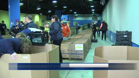 Volunteers with Hunger Task Force pack holiday meal boxes